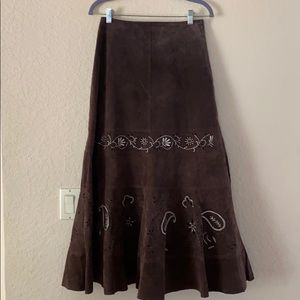 Genuine leather skirt with off white embroidery.